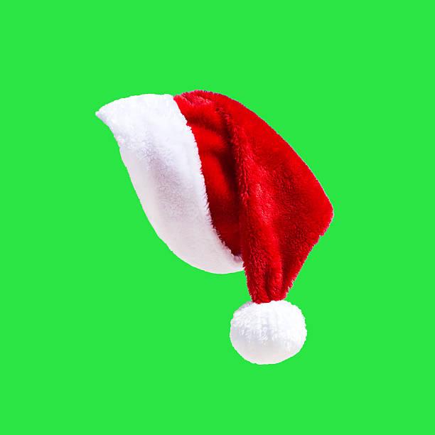 Santa Claus hat on green stock photo