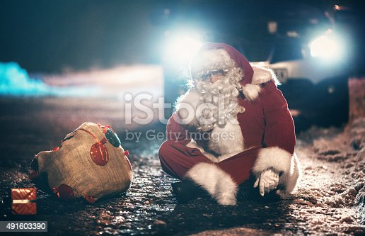 istock Santa Claus having car trouble. 491603390