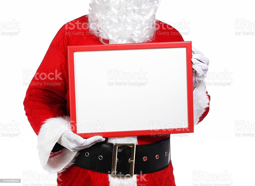Santa Claus holding a billboard stock photo
