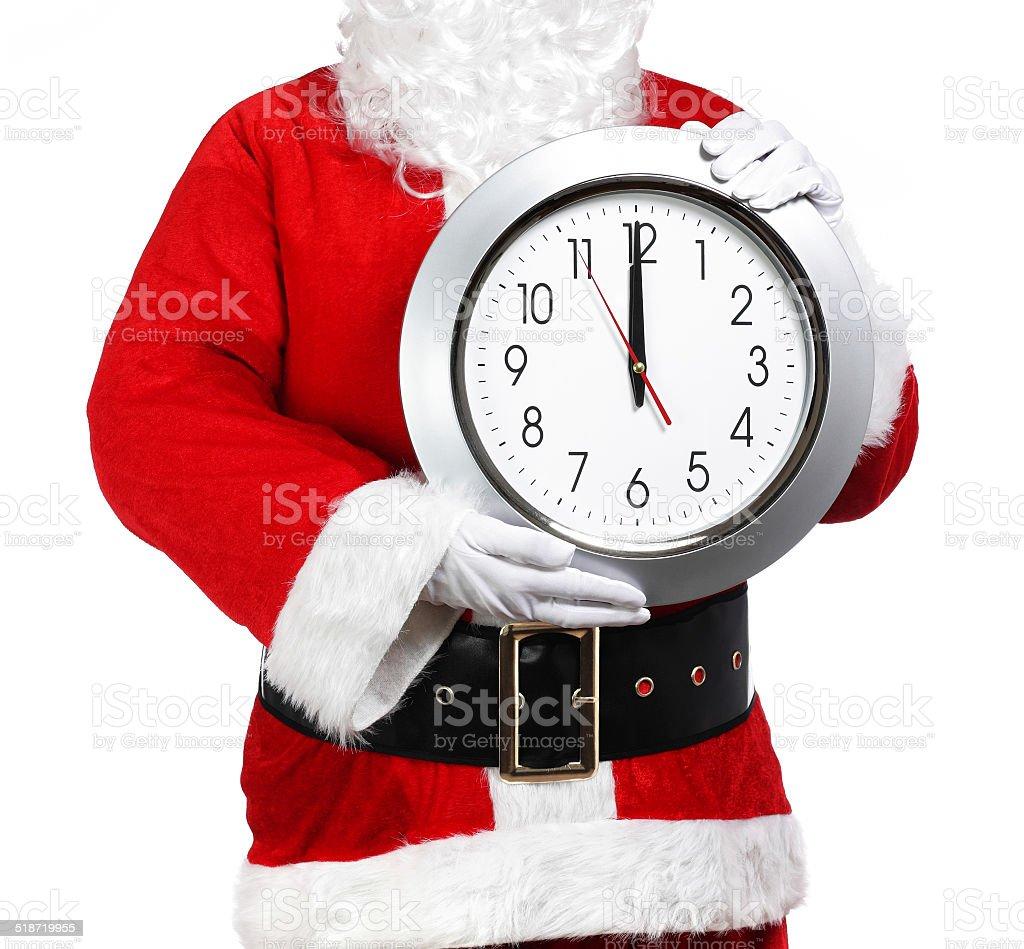 Santa Claus holding a clock stock photo