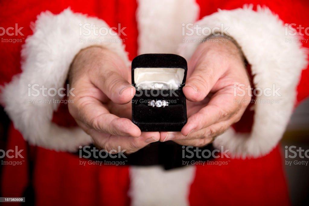 Santa Claus Holding a Diamond Ring royalty-free stock photo