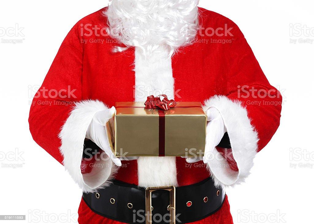 Santa Claus holding a gift stock photo