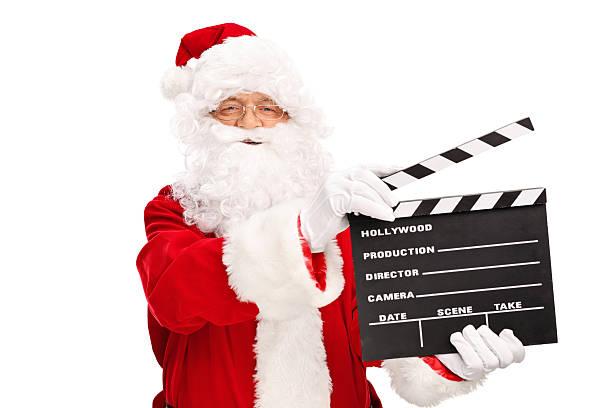 santa claus holding einen film erste klappe fällt - klappe hut stock-fotos und bilder