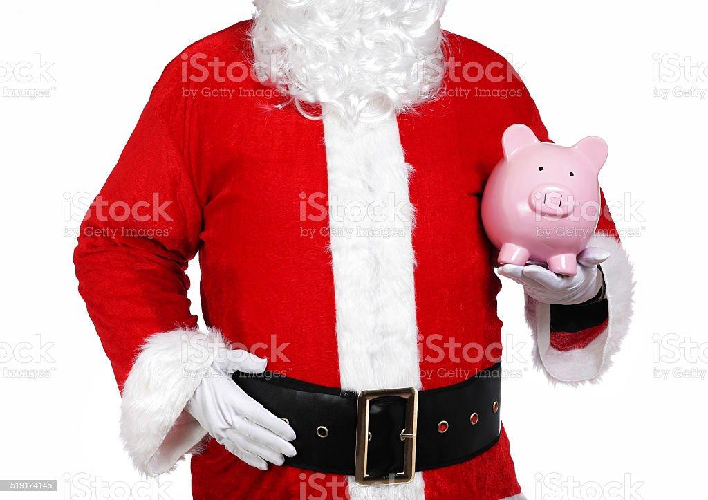 Santa Claus holding a piggy bank stock photo