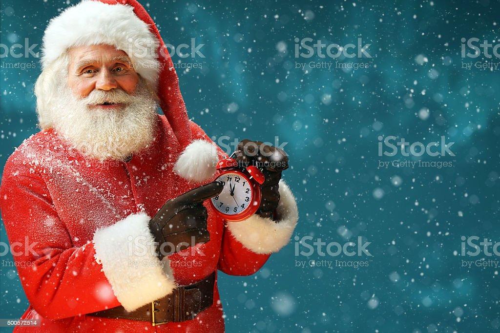 Santa Claus holding alarm. Merry Christmas! stock photo