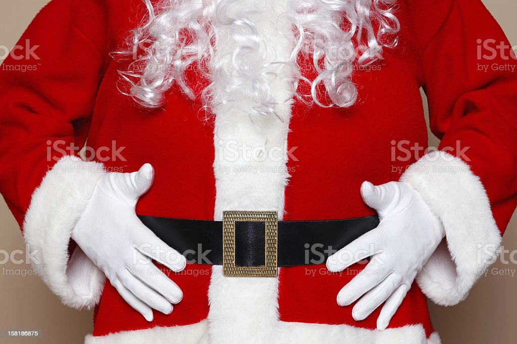 Santa Claus holding his belly stock photo