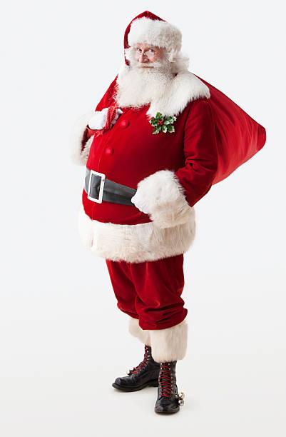 santa claus holding geschenk tasche - santa stock-fotos und bilder