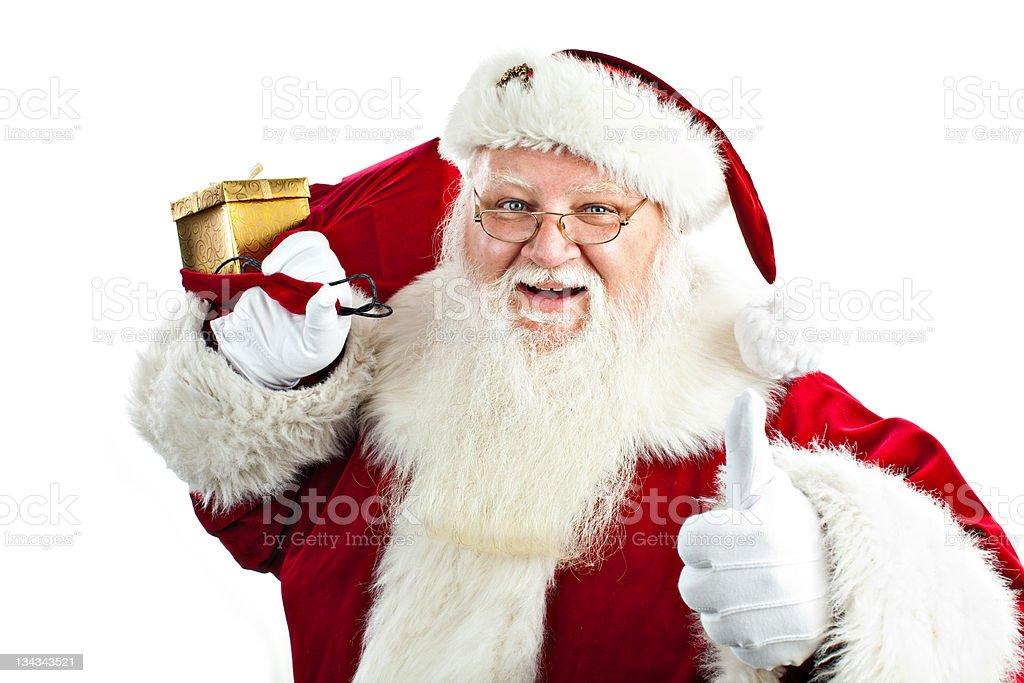 Santa claus holding his magic sack with presents royalty-free stock photo