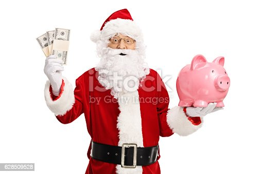 621898406 istock photo Santa claus holding money bundles and a piggybank 628509528