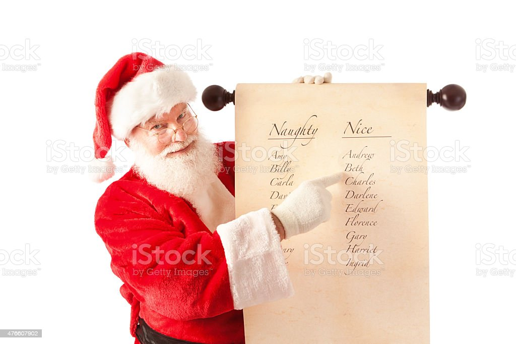 Santa Claus Holding Name List of Naughty and Nice stock photo