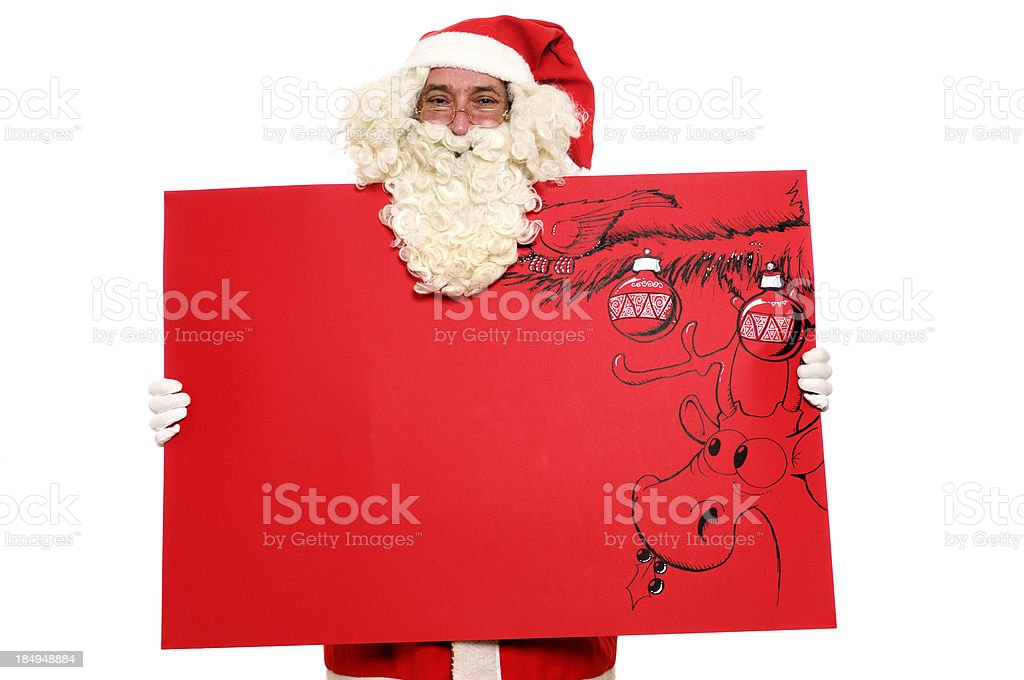 Santa Claus Holding Red Christmas Card stock photo