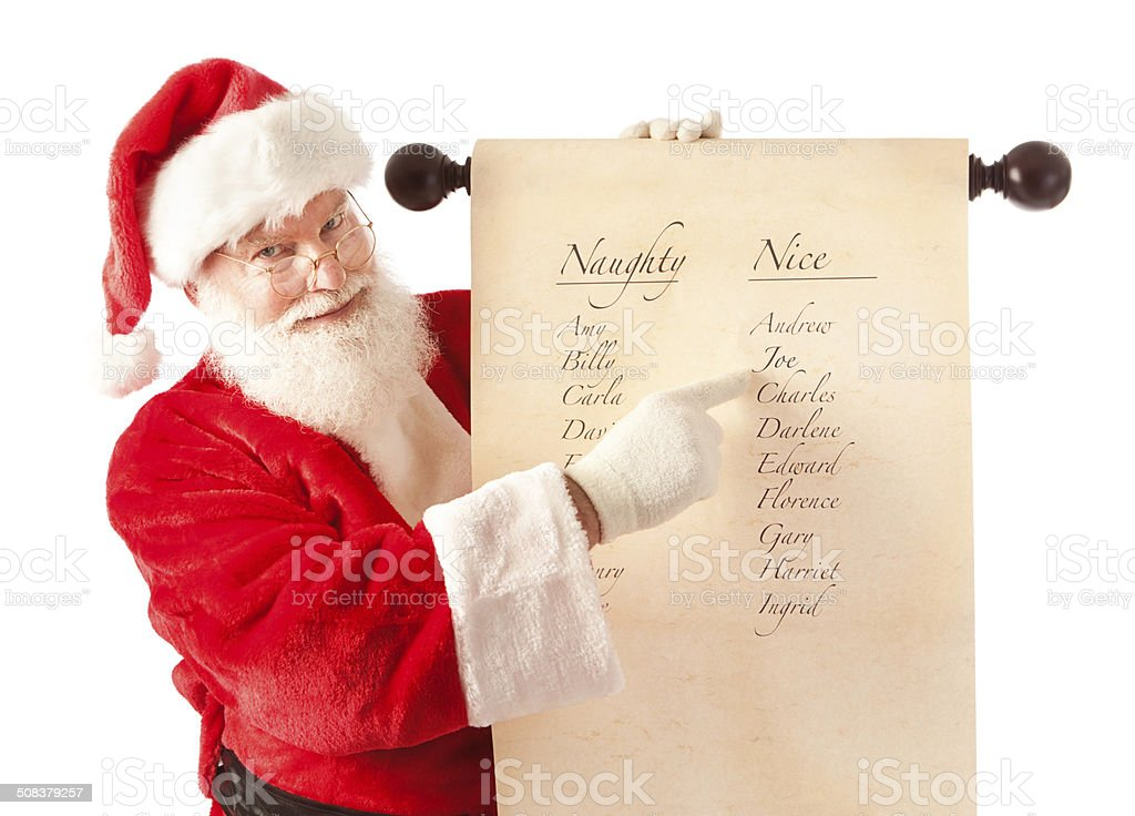 Santa Claus Holding Scroll of Naughty and Nice Name List stock photo