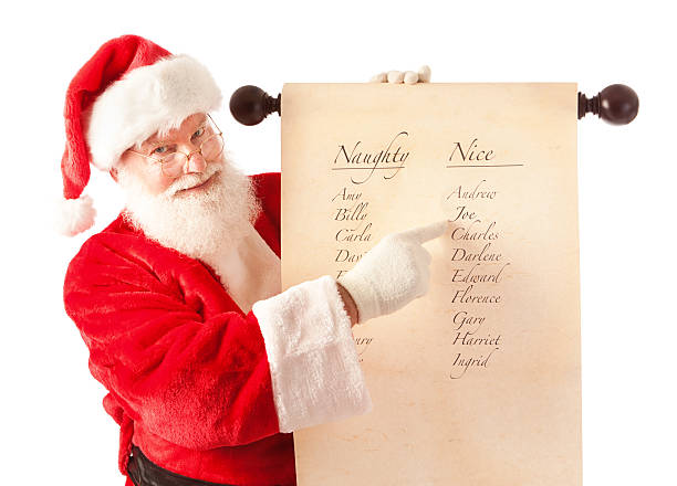 santa claus holding scroll of naughty and nice name list - mischief stock photos and pictures