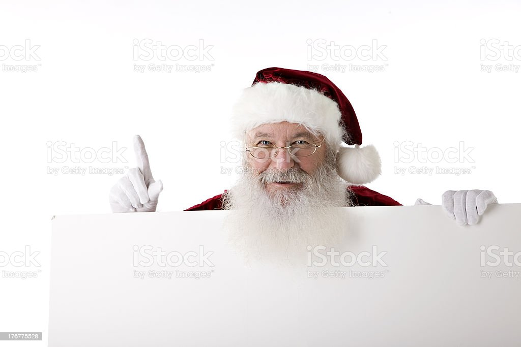 Santa Claus Holds Up a Blank Sign royalty-free stock photo