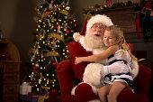 istock Santa Claus hugging a child 507882187