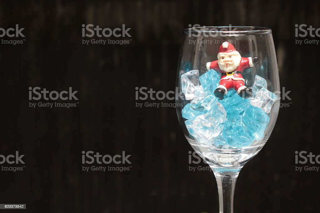Santa Claus in a glass of wine with ice zbiór zdjęć royalty-free