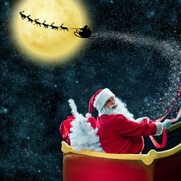 Santa Claus in his deer sled near the moon Santa Claus in his deer sled near the moon. On night sky background sleigh stock pictures, royalty-free photos & images