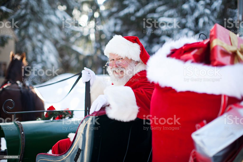 Santa Claus in His Sleigh at North Pole stock photo