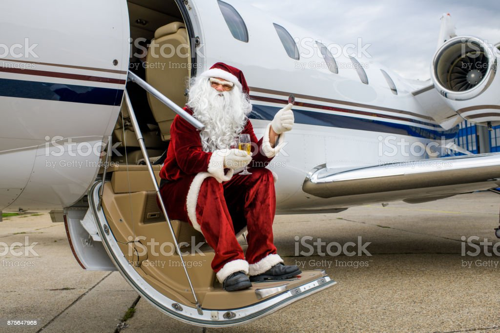 Santa Claus in private jet airplane stock photo