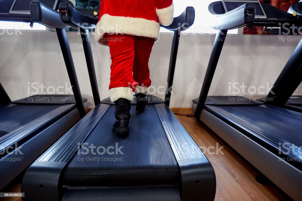 Santa Claus in the gym doing exercises stock photo