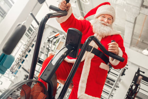 Santa Claus in the gym holiday concept stock photo