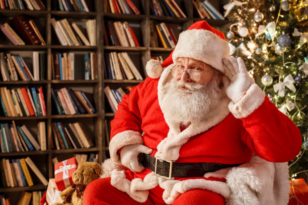 Santa Claus in the library christmas new year concept stock photo