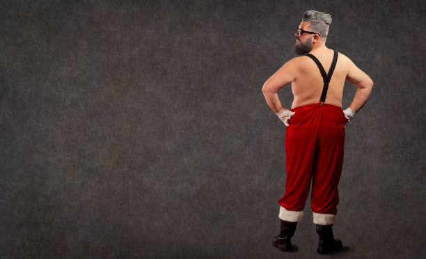 santa claus is a modern hairstyle with a naked body. - naked santa claus stock pictures, royalty-free photos & images