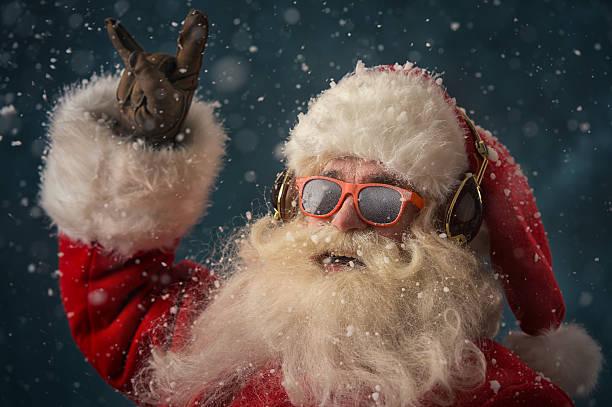 Santa Claus is listening music stock photo