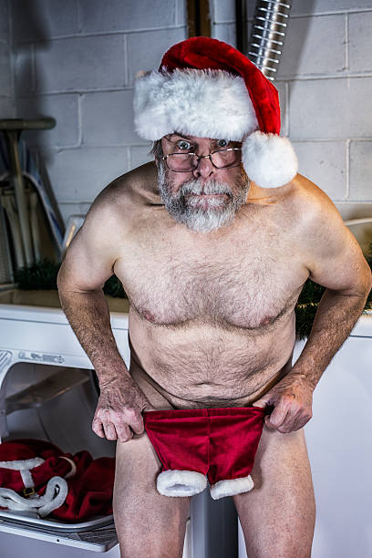 santa claus is naked and shocked with shrunken costume pants - naked santa claus stock pictures, royalty-free photos & images