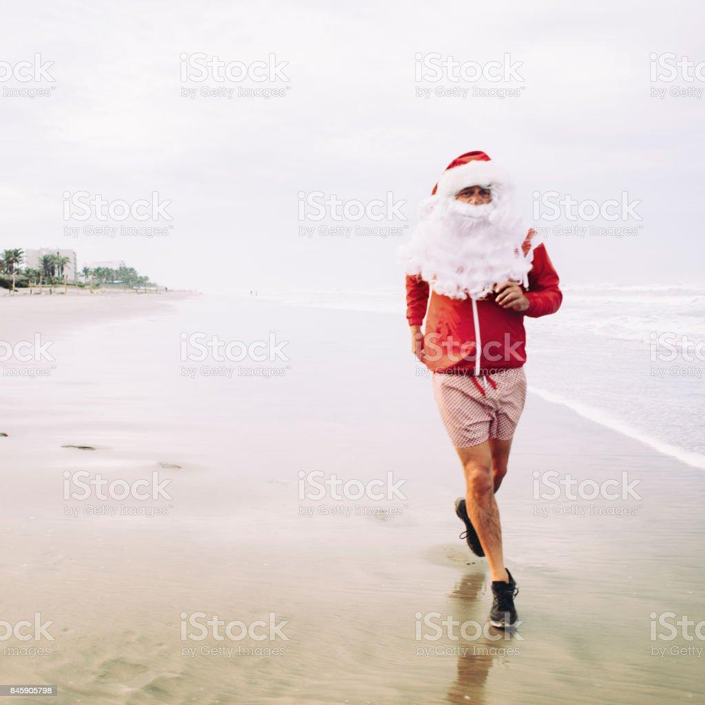 Santa Claus Joggen am Strand - Lizenzfrei 60-69 Jahre Stock-Foto