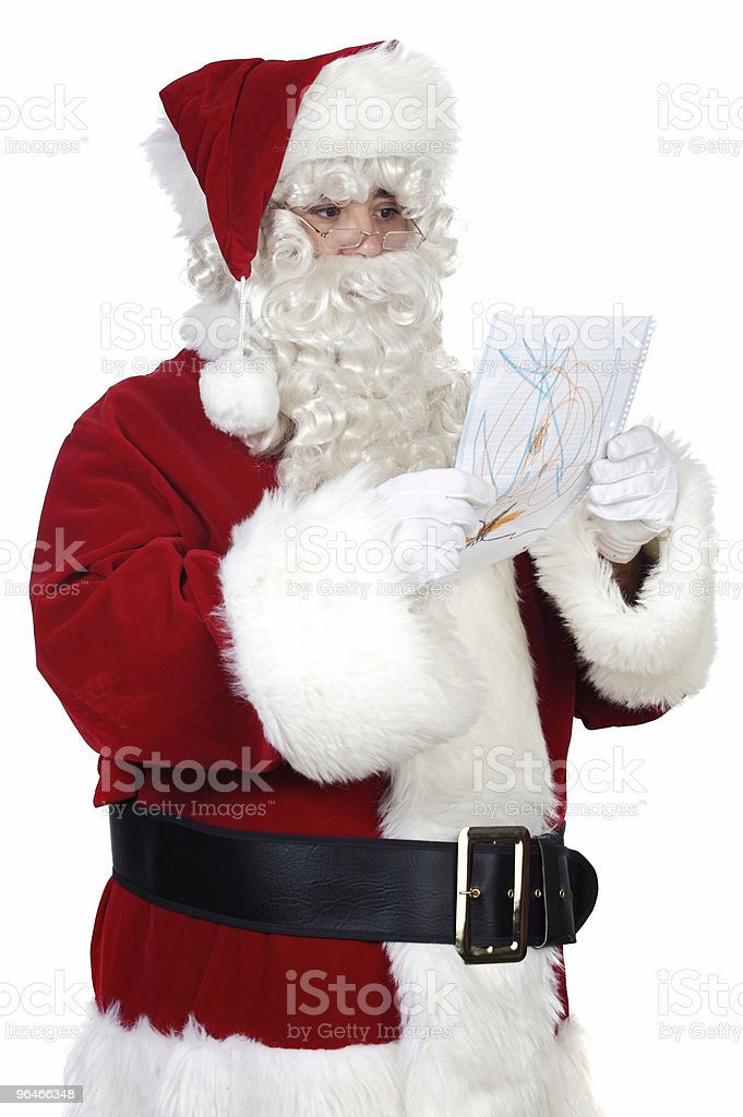 Santa Claus looking a drawing royalty-free stock photo