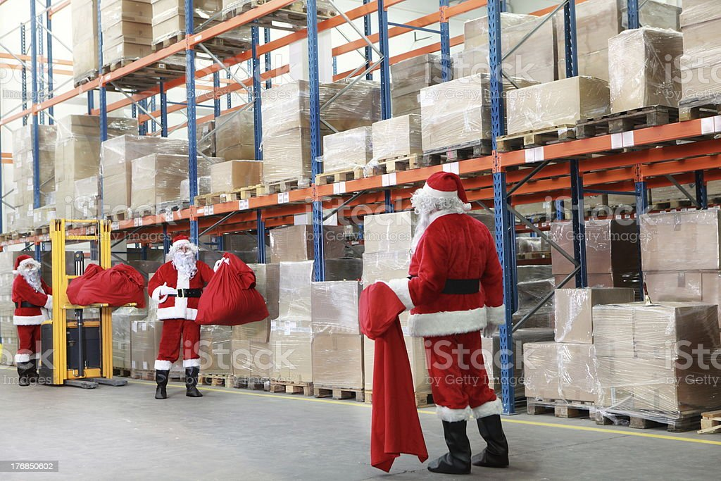 Santa claus looking for gifts in storehouse royalty-free stock photo