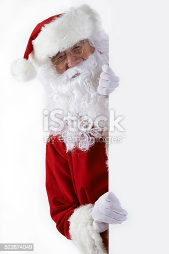 istock Santa Claus Looking Round Blank White Wall 522674049