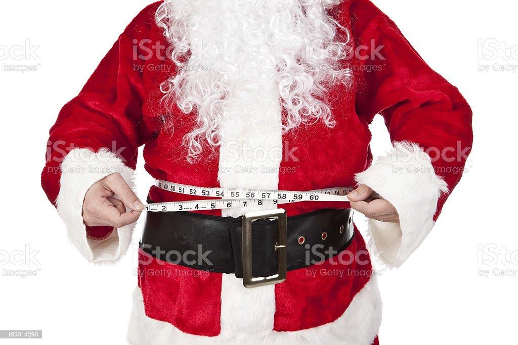 Santa Claus Measuring Fat Belly royalty-free stock photo
