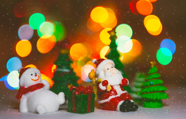 Santa Claus model on blurred of colorful bokeh illumination background, concept of Christmas.