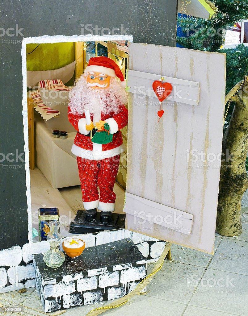 Santa Claus near his house royalty-free stock photo