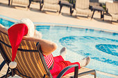 Santa Claus near the pool holiday concept lie sunbed