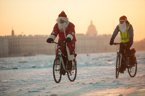 Santa Claus on a bike with an accordion