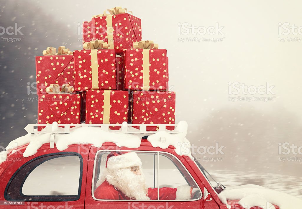 Santa Claus on a red car full of Christmas present foto stock royalty-free