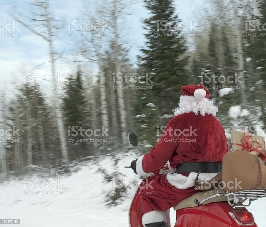 Santa Claus on a scooter royalty-free stock photo