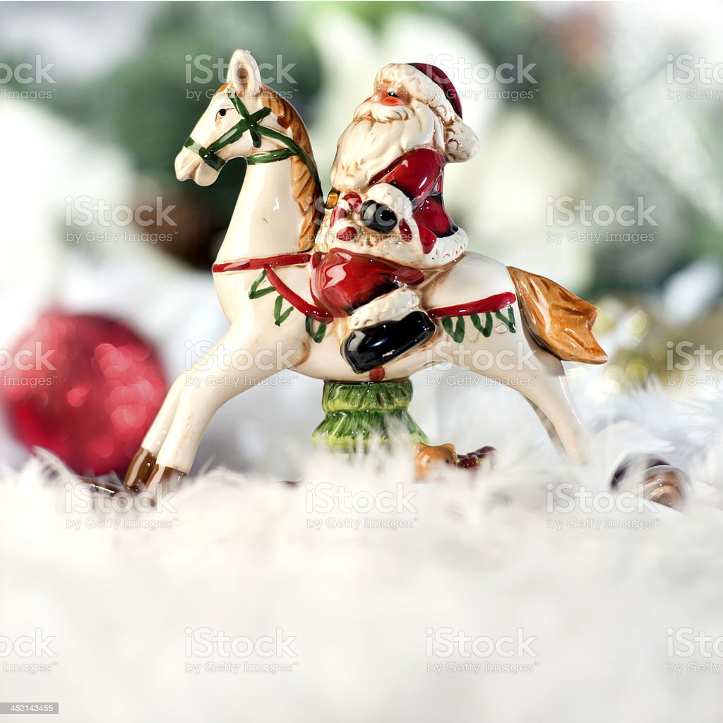 Santa Claus on a white rocking horse Christmas decoration royalty-free stock photo