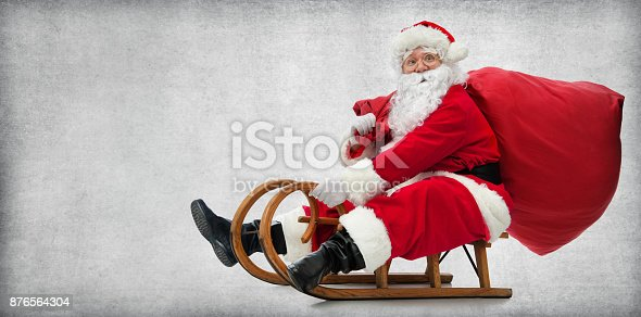 istock Santa Claus on his sledge 876564304