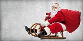 istock Santa Claus on his sledge 876564304