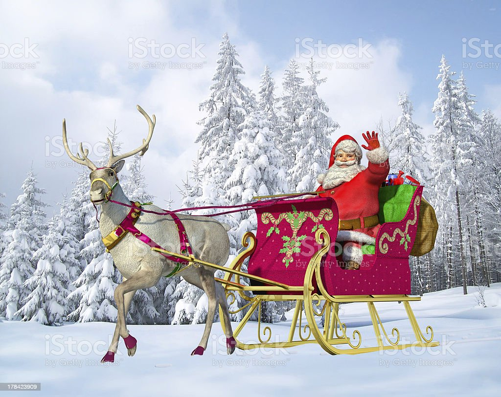 Santa Claus on his sleigh and reindeer. stock photo