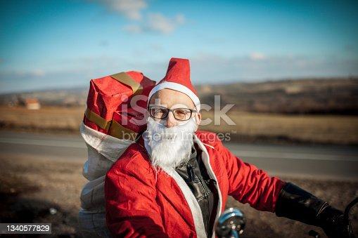 istock Santa Claus on Motorcycle 1340577829