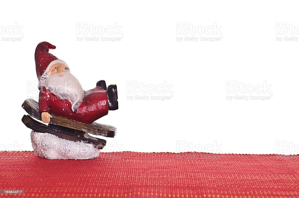 Santa Claus on red textile with christmas ball royalty-free stock photo