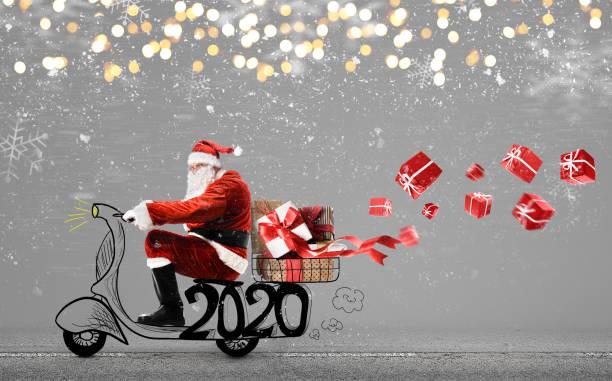 Weihnachtsmann auf Roller – Foto
