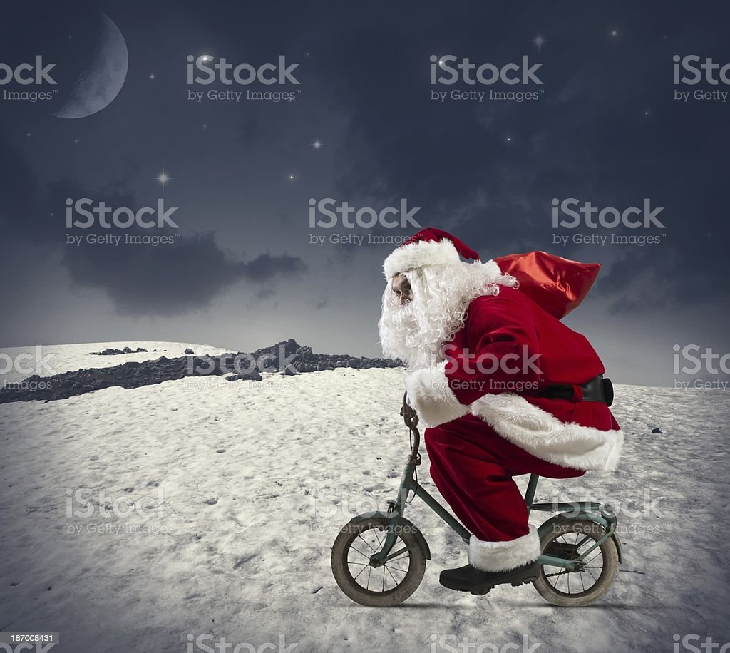 Santa claus on the bike royalty-free stock photo