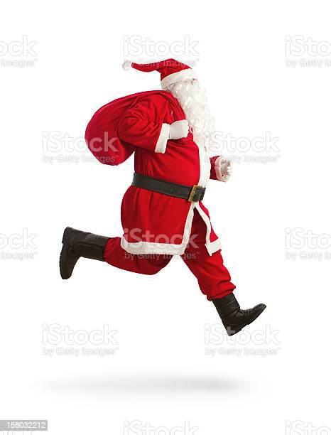 Santa Claus En La Ejecución Foto de stock y más banco de imágenes de Adulto