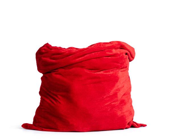 santa claus open rode tas vol, geïsoleerd op witte achtergrond. bestand bevat een pad naar isolatie. - zak tas stockfoto's en -beelden